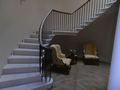 curved wreath handrail on wrought iron and cantilevered stone staircase 1